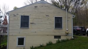 Before-Siding job in Middlesex, NY