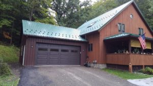 28x24x10 post frame garage with Ivy Green roofing, Brown siding_Honeoye, NY