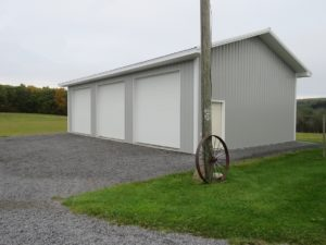 28x48x12 pole building with 2' overhangs, Gray siding, Brite White trim_Branchport, NY
