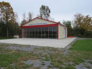 45x44x14 post frame airplane hanger with Ivory siding, Crimson Red roofing and trim_Bloomfield, NY