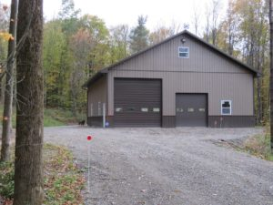 45x48x16 pole building with 2' overhangs, Buckskin siding, Brown wainscot, roofing and trim_Springwater, NY