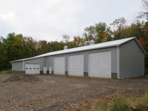 48x104x16 pole building with 1' overhangs, Gray siding, Brite White roofing and trim_Sodus, NY